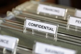 Confidential file in filing cabinet