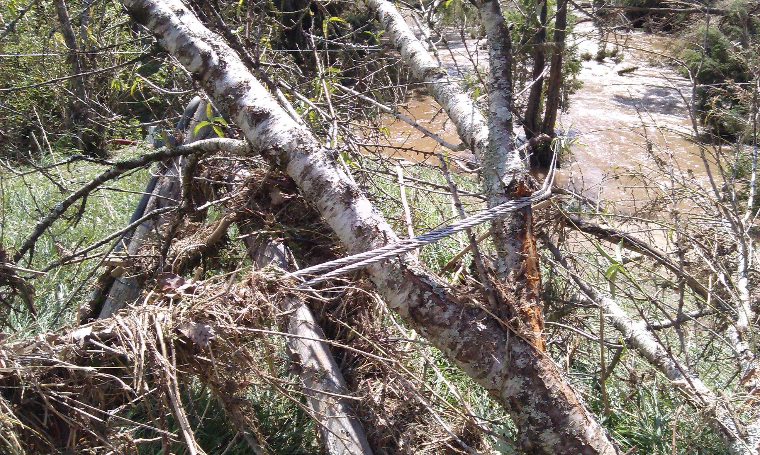 Fallen powerlines across flooded creeks (2)