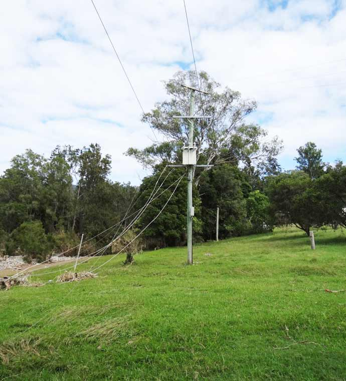 Fallen powerlines across flooded creeks