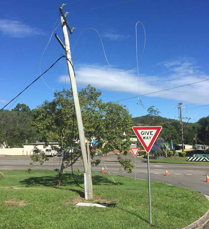 Broken power pole and fallen powerlines Sunshine Coast