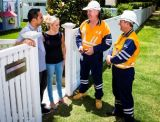 Customers talking to Energex workers