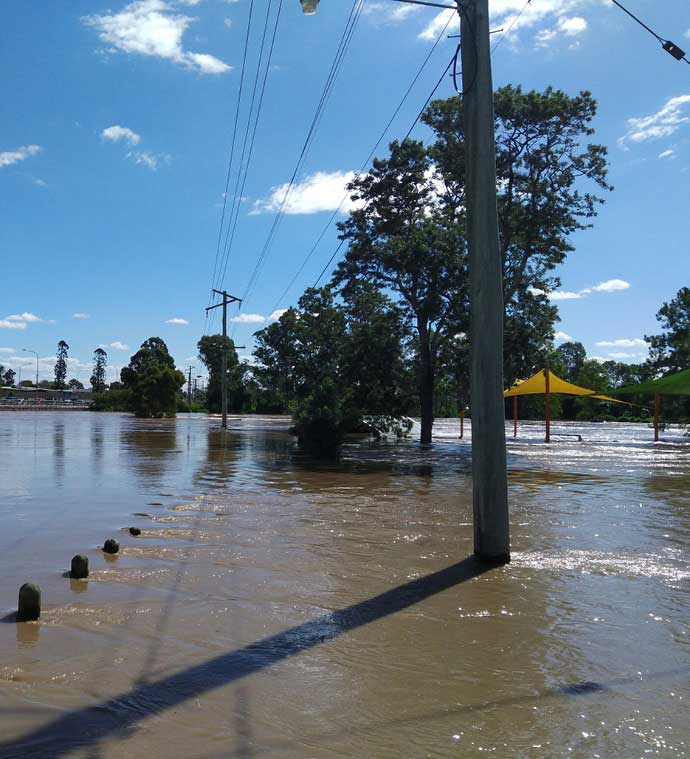 Waters rising around powerlines